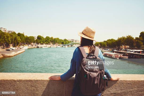 a female tourist looking at Seine