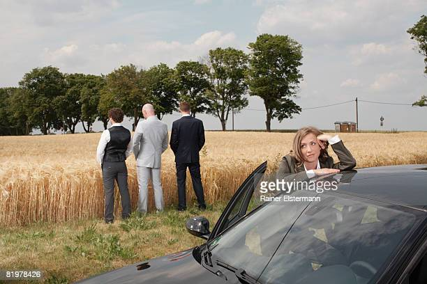 a few people on a business trip with car - urinating stock pictures, royalty-free photos & images