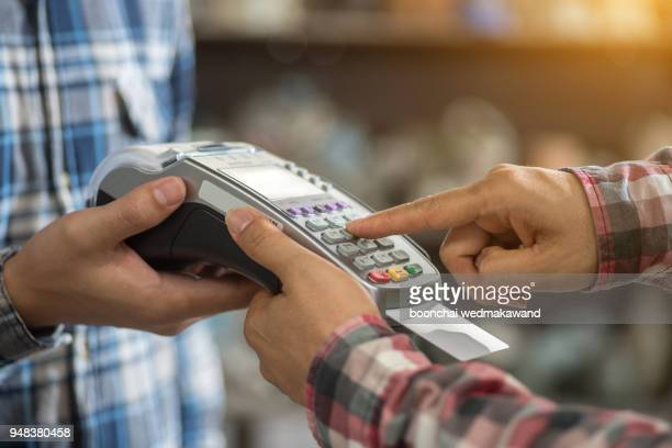 a finger press on credit card