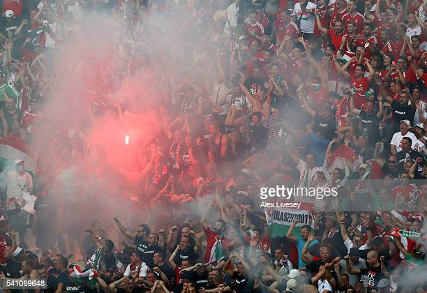 a flare is set off within the Hungary supporters during the UEFA EURO 2016 Group F match between Iceland and Hungary at Stade Velodrome on June 18...