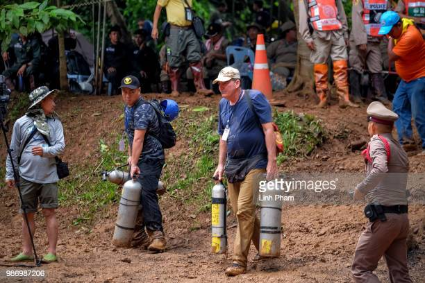 a foreign diver walks out of Tham Luang Nang Non cave on June 29 2018 in Chiang Rai Thailand Rescuers in northern Thailand looked for alternative...