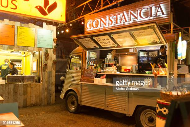 a former 2 chevaux citroen truck transformed in a food truck at night