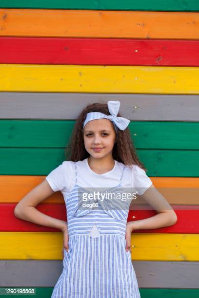 a girl of 8-10 years old stands near the wall - 10 11 years stock pictures, royalty-free photos & images