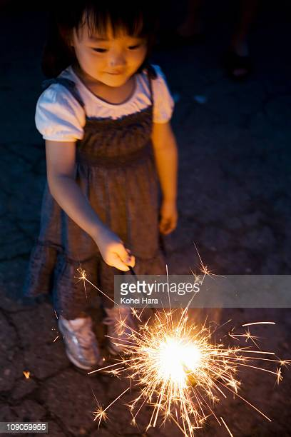 a girl playing small fireworks
