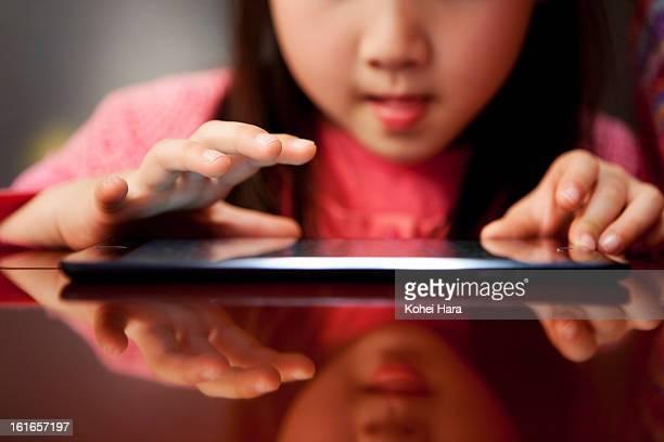 a girl using a digital tablet