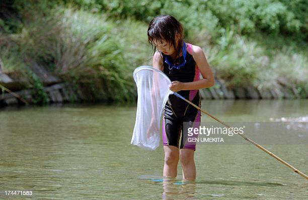 a girl who catch a fish