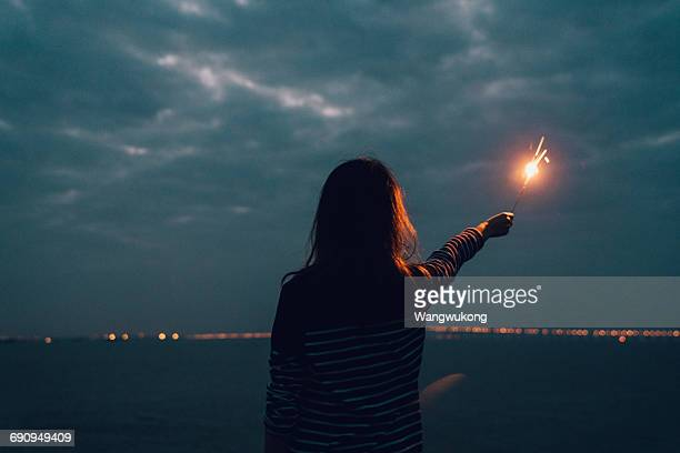 a girl with fireworks - sparkler stock pictures, royalty-free photos & images