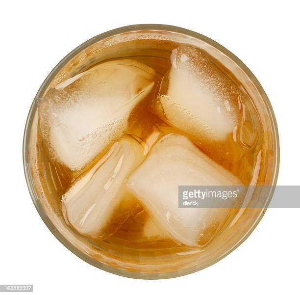 a glass of ice tea with ice cubes