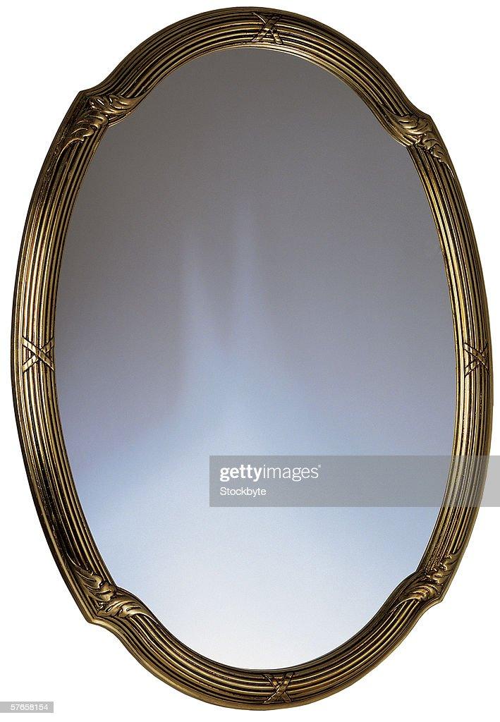a golden framed mirror : Stock Photo