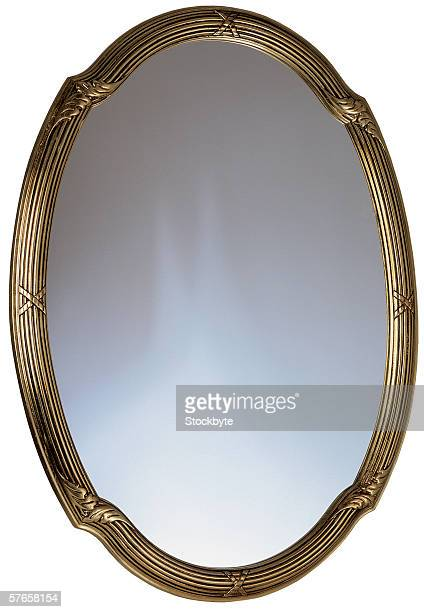 a golden framed mirror - mirror frame stock photos and pictures