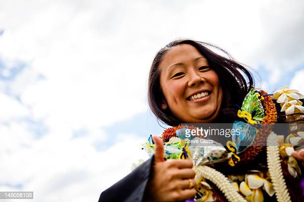 a graduate is shrouded in Hawaiian Leis (lays) on her graduation day from the University of New Haven.