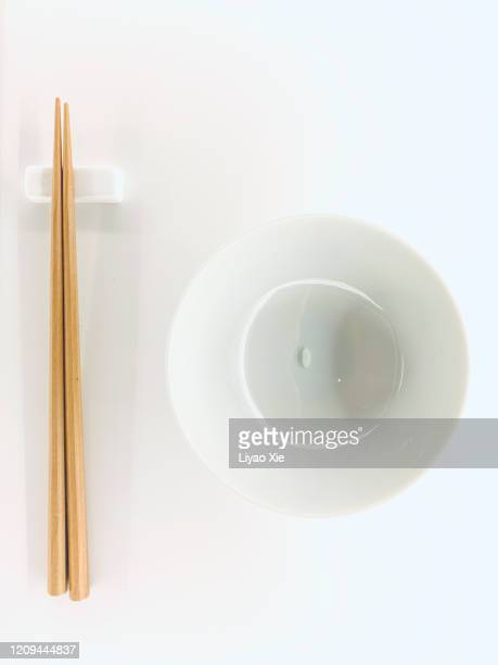 a grain rice with chopsticks - liyao xie stock pictures, royalty-free photos & images