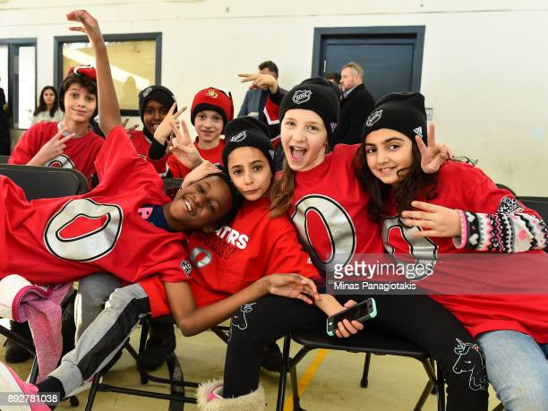 a group of children pose for a photo during the 2017 Scotiabank NHL100 Classic Legacy Project press conference at the Boys Girls Club Police Youth...