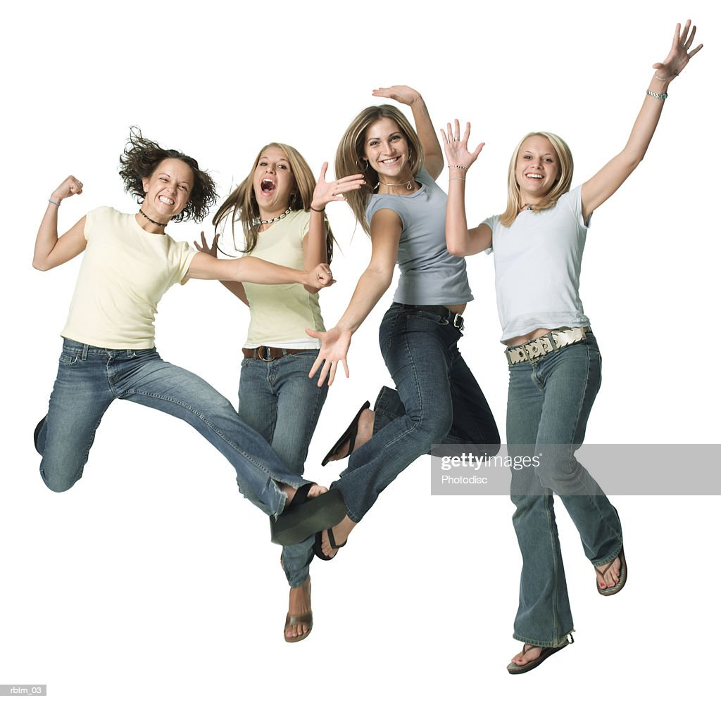 a group of four caucasian female teens jump up playfully into the air : Foto de stock