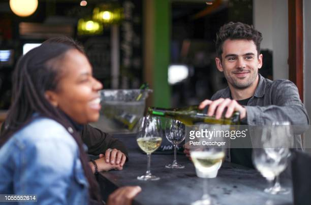 a group of friends enjoying some wine. - stellenbosch stock pictures, royalty-free photos & images
