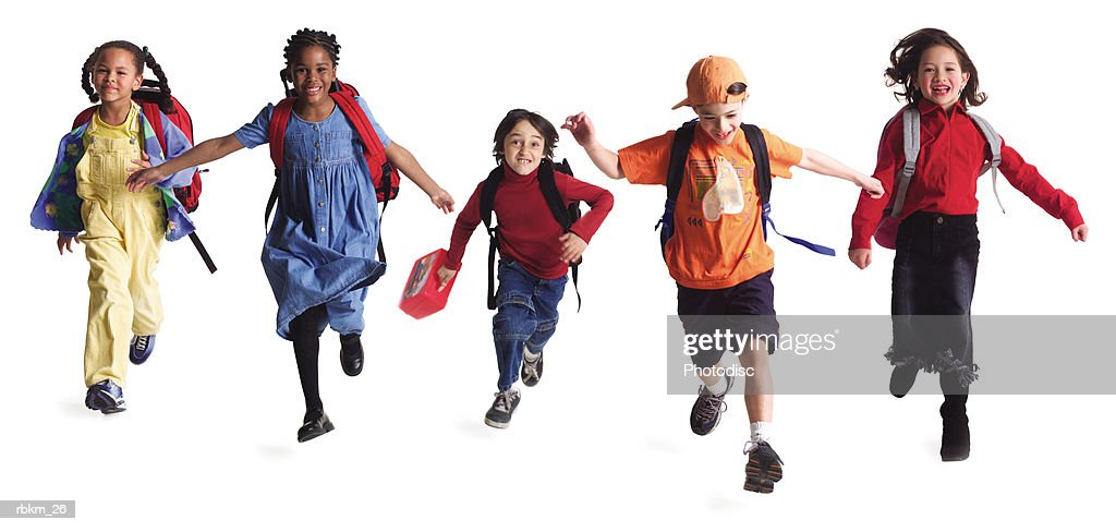 a group of kids with backpacks run forward as if just getting out of school : Stock Photo