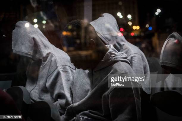 a group of migrants waiting on the bus to be transferred to a center Malaga Spain