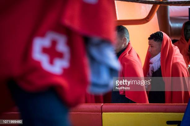 a group of migrants waiting to be transferred to the Care unit On 7 December 2018 in Malaga Spain The Spanish Maritime vessel the quotSAR...