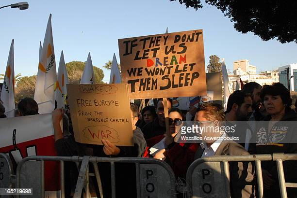 A group of people demonstrating in front of the cypriot parliament against the bank levy. Eurogroup decision