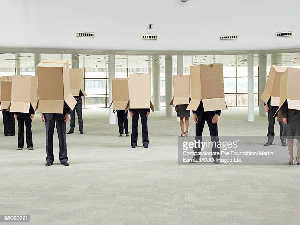 a group of people with boxes over their heads