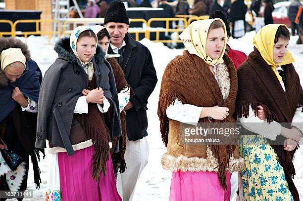 CONTENT] a group of women wearing romanian traditional costume after performing traditional carols in a public square in cluj napoca romania