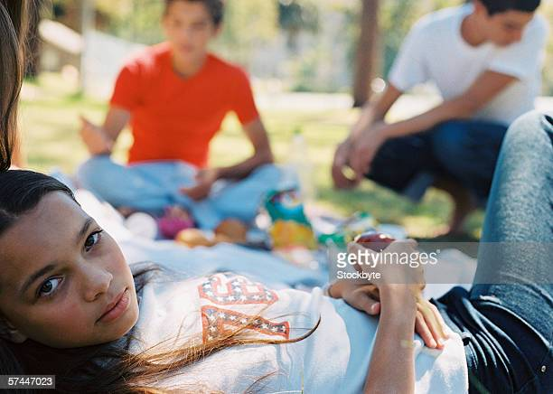 a group of young teenagers at a picnic