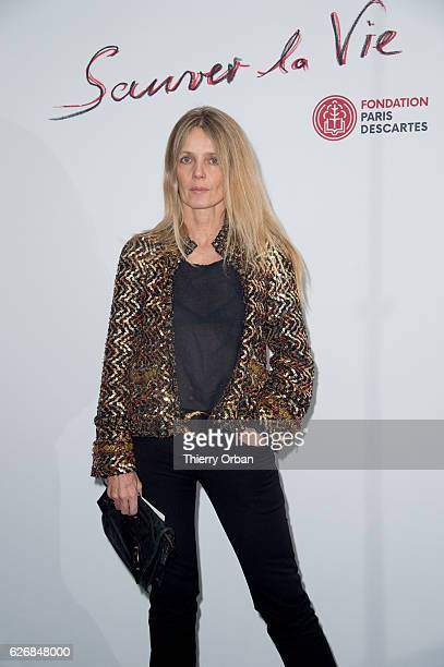 a guest attend the diner 'sauver la vie' Eric Pfrunder Hosts 'Sauver La Vie' Diner for Paris Descartes Fondation at Pavillon Ledoyen on November 30...