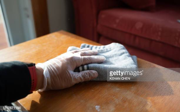 a hand wiping table surfaces - hygiene stock pictures, royalty-free photos & images