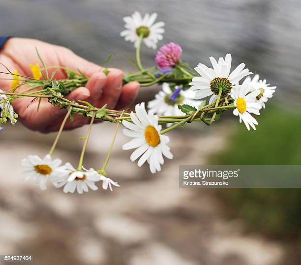 a hand with wildflowers crown