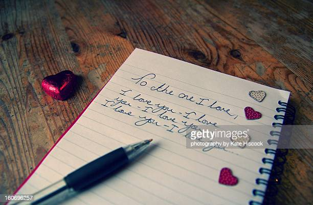a hand written love letter with hearts