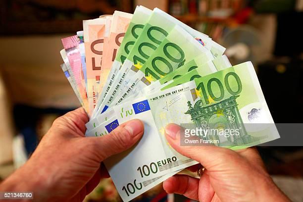 a handful of euros bills