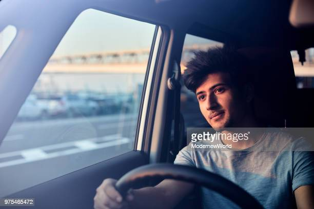 a handsome nepalese male smiling in the car in the afternoon - モータービークル ストックフォトと画像