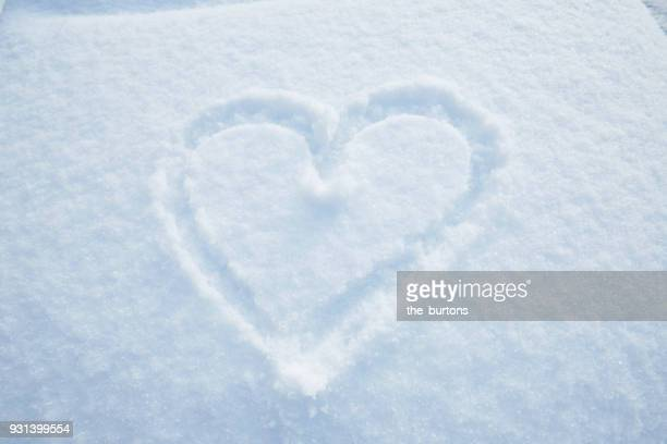 a heart drawn in snow