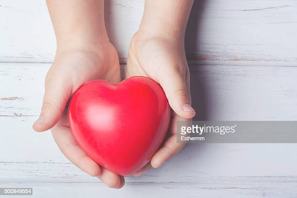 a heart in the hands of a child