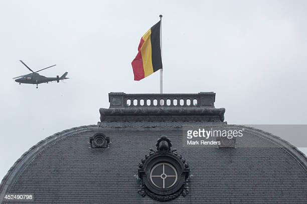 A helicopter flies over the Royal Palace on National Day on July 21, 2014 in Brussel, Belgium.