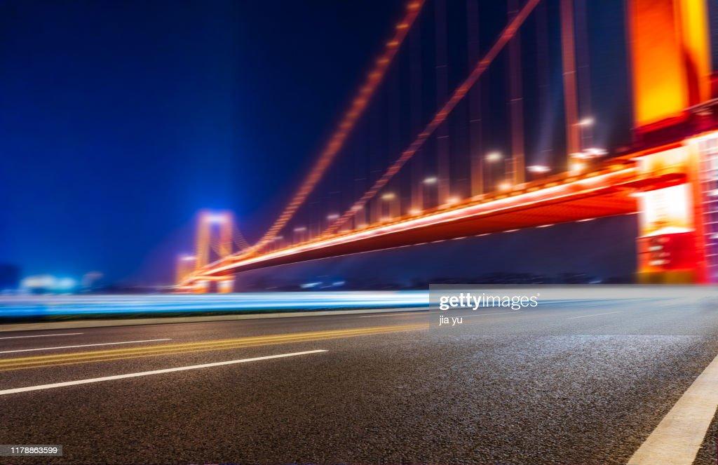 a highway under Yangtze river bridge in Wuhan : Stock Photo