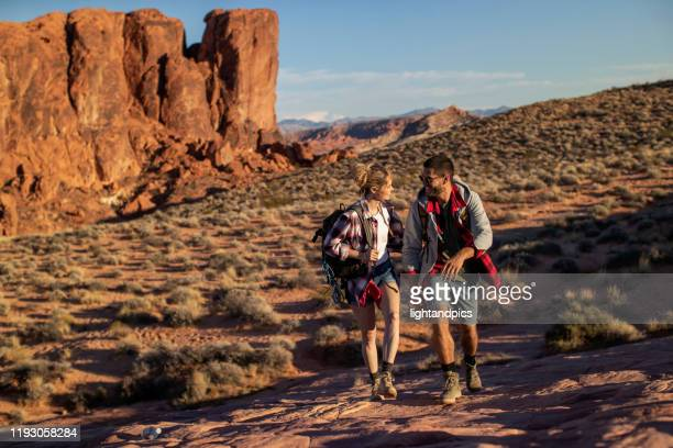 a hiker couple - valley of fire state park stock pictures, royalty-free photos & images