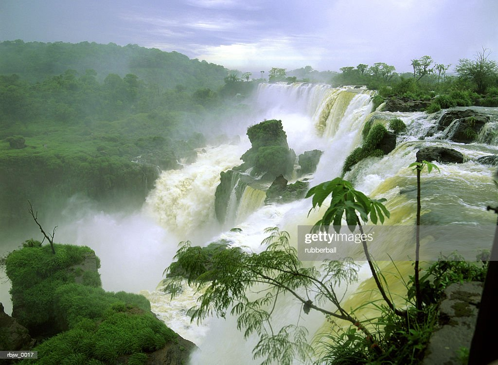 a horizontal of a lush jungle waterfall in south america or africa : Stockfoto