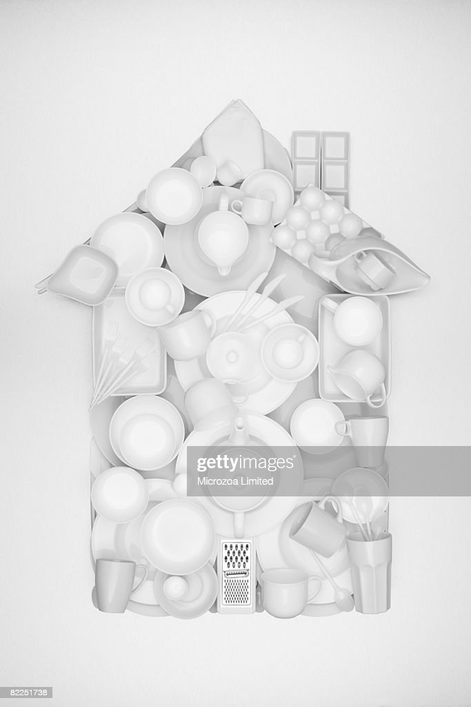 a house shape made from ceramic crocery : Stock Photo