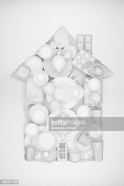 a house shape made from ceramic crocery - microzoa stock pictures, royalty-free photos & images
