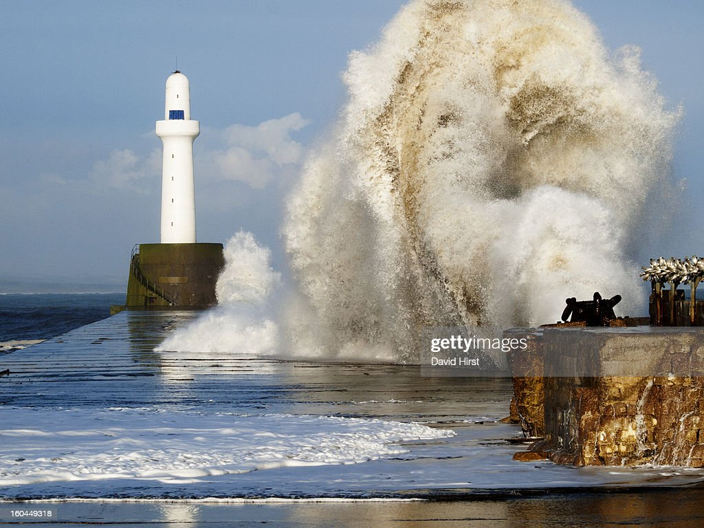 CONTENT] a huge North Sea storm wave hits southern breakwater with lighthouse at Aberdeen Harbour, on the Arberdeenshire coast Scotland, October 2011