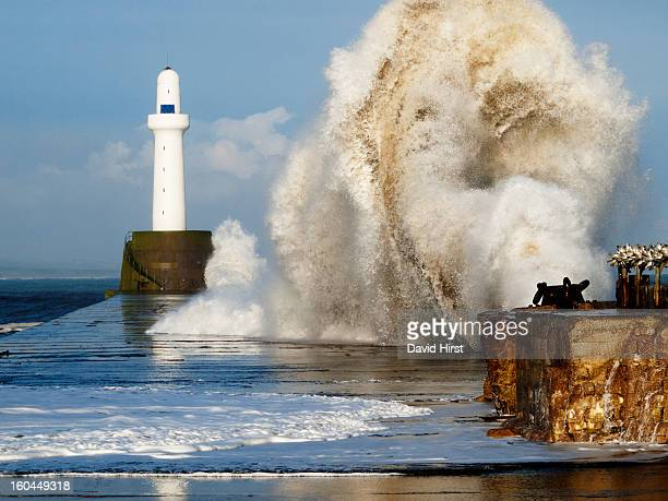 A huge North Sea storm wave hits southern breakwater with lighthouse at Aberdeen Harbour, on the Arberdeenshire coast Scotland, October 2011