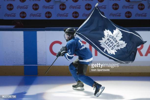 a kid skates with the Leafs team flag before the regular season NHL game between the Vancouver Canucks and the Toronto Maple Leafs on January 6 2018...