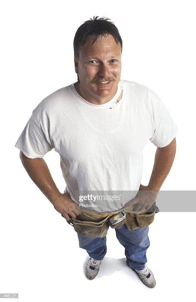a large adult man in jeans and a white tee shirt smiles up at the camera : Stockfoto