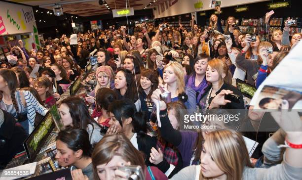 a large crowd waits for teenage pop sensation Justin Bieber tomeet fans and sign copies of his debut album 'My World' at HMV Westfield Shopping...