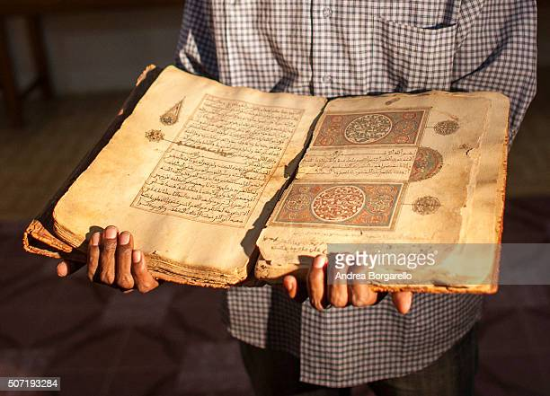 a librarian in Juma Al Majid Centre for the manuscripts conservation and restoration of Timbuktu shows one of the old manuscripts on January 19 2010...