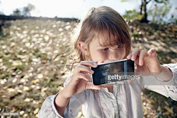 a little girl is taking a self portrait - photo messaging stock photos and pictures
