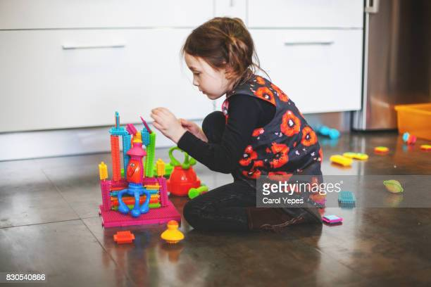 a little  girl(5) playing colorful blocks