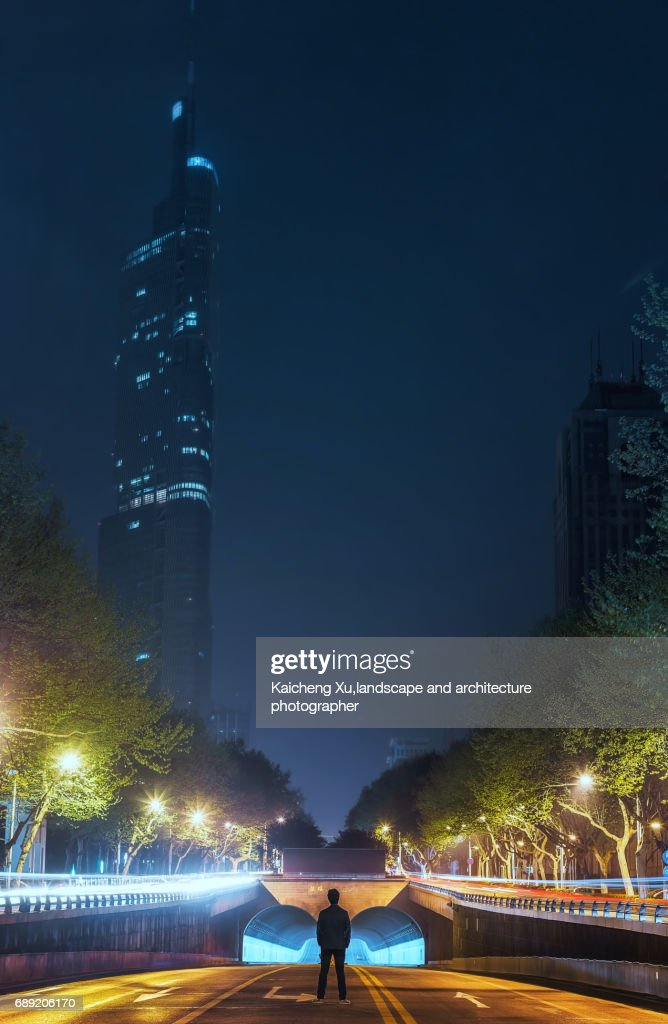a lonely man standing in centre of the road, Nanjing : Stock Photo