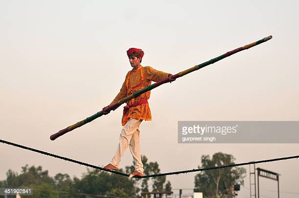 A man balancing on rope at a festival in chandigarh